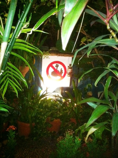 "The Palace's ""No chickens allowed"" sign"