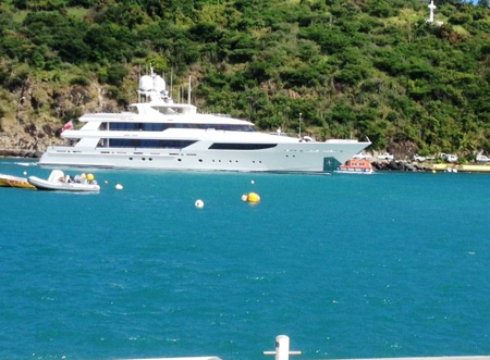 A yacht sails into Gustavia Harbor to find its berth