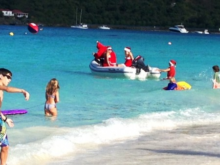 Everyone rushes to see Santa and his helpers arrive on St. Jean Beach on Christmas Day