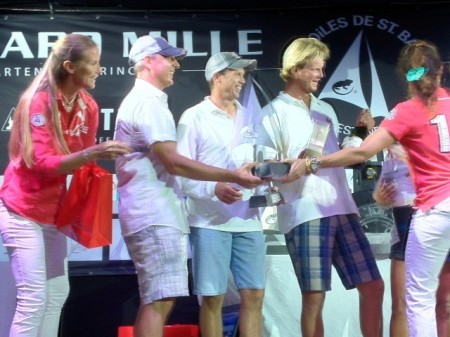 Benoit (left) receives the first place trophy in the Spinnaker One class for their sailboat, Coors Light
