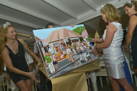 Peg's surprise gift - a painting of the St. Barth Properties team