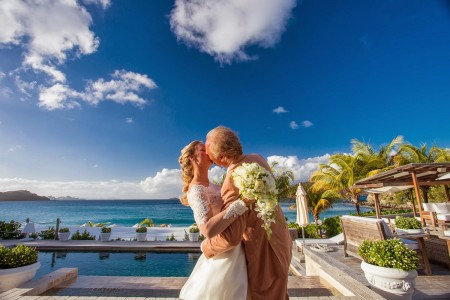 Roy and Mary enjoy a wedding day kiss before the reception at the Hôtel St. Barth Isle de France.