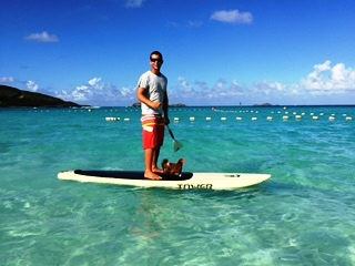 January 24, 2015 Paddle boarding with a very much alive chicken St. Jean Beach!