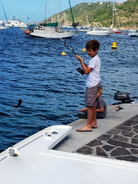 Two local St. Barth children try their luck at  fishing - catch and release - in Gustavia on a Sunday morning